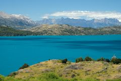 Tropical blue lake General Carrera, Chile with landscape mountains 2 royalty free stock photography
