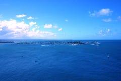 Tropical Blue ocean. Blue ocean blue sky and isla de cangrejos in Puerto Rico Stock Images