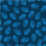Tropical blue palm tree leaves in a seamless pattern.  Stock Photos