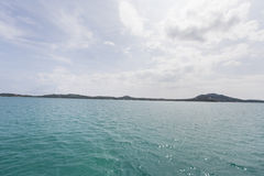 Tropical blue sea with island in background, Koh Samui, Thailand Royalty Free Stock Photos