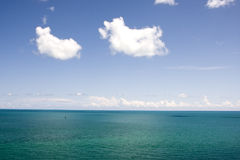 Tropical Blue Water with Clouds Royalty Free Stock Photo