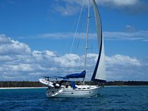 Tropical Blue Water Sailing near Fraser Island,. A picturesque tropical sailing image off pristine Coongul Beach with blue sky and white cloud on Fraser Island Royalty Free Stock Photography