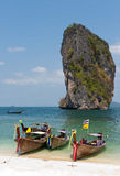 Tropical boats and rock. Classical long-tail boats on rock background. Thailand Royalty Free Stock Image