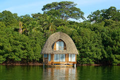 Tropical bungalow over water thatched roof Stock Photos