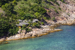 Tropical bungalow on a rocky beach next to the sea. Koh Phangan Island, Thailand Stock Images