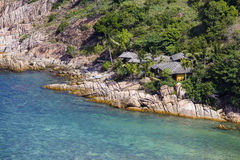 Tropical bungalow on a rocky beach next to the sea. Koh Phangan Island, Thailand Royalty Free Stock Photography