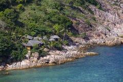 Tropical bungalow on a rocky beach next to the sea. Koh Phangan Island, Thailand Royalty Free Stock Photo