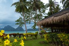 Tropical bungalow and wild beauty of El Nido, Philippines and amazing sea royalty free stock photo