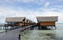 Tropical bungalows over sea. Over-water bungalows in resort island in Maldives Stock Photos