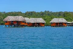 Tropical bungalows over water Stock Images