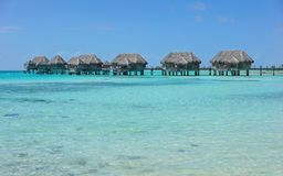 Tropical bungalows overwater in turquoise water Stock Photography