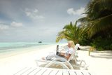 Tropical business woman with laptop Stock Images
