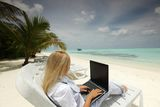 Tropical business woman with laptop Stock Image