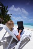 Tropical business woman with laptop Stock Photos