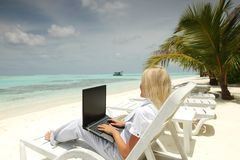 Tropical business woman with laptop Royalty Free Stock Image