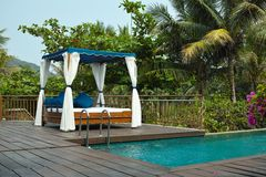Tropical cabana and swimming pool Royalty Free Stock Image