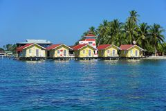 Tropical cabins over water of the Caribbean sea Royalty Free Stock Image