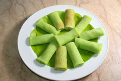 Tropical cake. Traditional cake from tropical country (indonesia),named dadar gulung royalty free stock image