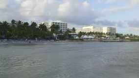 Tropical Caribbean beachfront hotel located in Montego Bay, Jamaica stock video