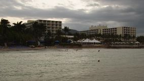 Tropical Caribbean beachfront hotel located in Montego Bay, Jamaica. Tropical beach resort Saint James Parish Montego Bay Jamaica stock video footage
