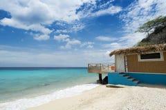 Tropical Caribean beach with beachhouse. Tropical beach (Kokomo beach) at Vaersenbaai Curacao Stock Images