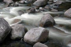 Tropical Cascade. Tropical stream cascades over rocks Stock Photo