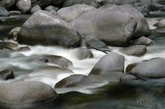 Tropical Cascade. Tropical stream cascades over rocks Stock Image