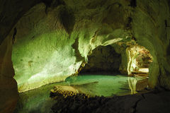 Tropical cave with sea water Royalty Free Stock Photo