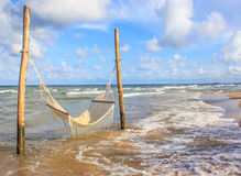 Tropical chilling moment - Hammock on the beach Stock Photo
