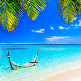Tropical chilling out - hammock in turquoise water. Stock Photography