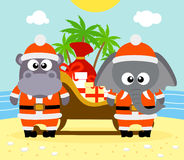 Tropical Christmas background with elephant and hippo Stock Images