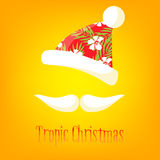 Tropical Christmas card. Mustache and hat of Santa with a summer ornament. Happy New Years background Royalty Free Stock Photo