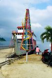 Tropical Christmas tree. In the village of Parapat, at the edge of Lake Toba on Sumatra, Indonesia, a Christmas tree made out of a fishing net next to a ferry royalty free stock image