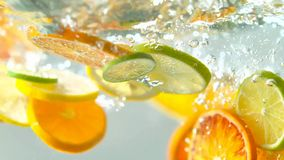 Tropical citurs fruits slice falling in water royalty free stock photos
