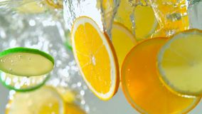 Tropical citurs fruits slice falling in water royalty free stock image