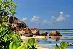 Tropical coast . The coast of island with the beautiful scene of the tropical nature, mountain, rocks ,sea & white clouds on the blue sky. The sky area is free Stock Photo