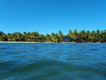 Tropical coast at the horizon with a beach house Stock Image