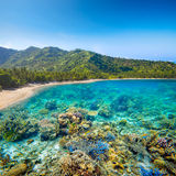 Tropical coast on Lombok,Indonesia under and above water. Royalty Free Stock Images