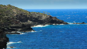 Tropical Coast (Maui, Hawaii). Panning shot on tripod of the rocky north coast of Maui in Hawaii stock video footage