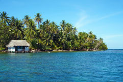 Tropical coast with rustic hut on stilts Stock Photography