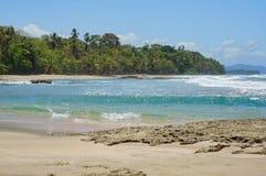 Tropical coastline Caribbean shore of Costa Rica. Tropical coastline on the Caribbean shore of Costa Rica, playa Chiquita, Puerto Viejo de Talamanca, Central Stock Photo