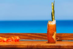 Tropical cocktail on a table at the beach Royalty Free Stock Images