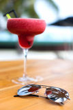 Tropical cocktail and sun glasses stock photos