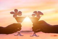 Tropical cocktails on the beach, couple. Of hands with glasses Royalty Free Stock Photos