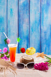 Tropical cocktails on blue wood and sand sex on the beach Stock Images