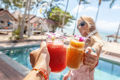 Tropical cocktails cheers woman. Healthy drink. Celebration and tropical party. Beautiful with tropical cocktails cheers woman. Celebration party. Summer beach stock photography