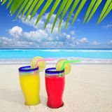 Tropical cocktails turquoise beach Stock Photos