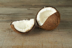 Tropical coconut, on a wooden table Royalty Free Stock Photo