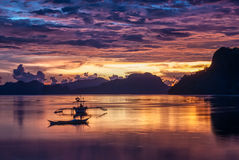 Tropical colorful sunset with a banca boat in El Nido Royalty Free Stock Photography