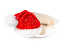 Tropical concept of new year with red Santa Claus hats in shell. Isolated on white background Stock Image